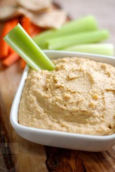 Fast/Easy Hummus Recipe  1 (15 ounce) can chickpeas   1/4 cup tahini paste   3 tablespoons fresh lemon juice   1 garlic clove   1/4 teaspoon ground cumin   salt and pepper
