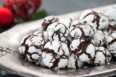 Chocolate cookie dough rolled in powdered sugar and baked into a festive black and white cookie. Perfect Christmas cookies! ~ SimplyRecipes.com
