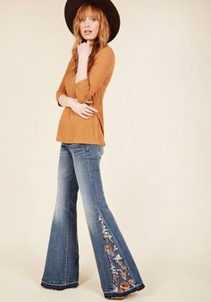 Insert Flowers Here Jeans | Mod Retro Vintage Pants | ModCloth.com  Seamlessly slip feminine flair into your style by sneaking into these medium wash jeans. Ivory, orange, burgundy, and sage floral embroidery appears at the high waistline, back pocket, and bell bottom inserts, joined by raw hemlines and slight distressing to secure a brilliantly boho-inspired look that teems with sweetness!
