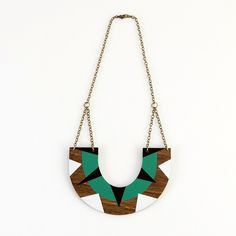 Dress up your look with this wooden statement necklace.