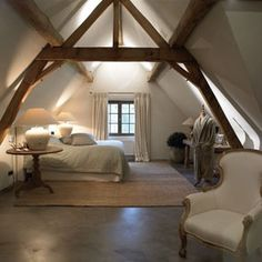 rustic wood beams and columns in bedroom with vaulted ceiling