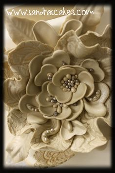 Love the detail of the edible tan flower, via Flickr. by Sandras Cakes - Simply Beautiful - See the cake.