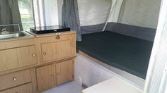 A thin foam futon mattress is perfect to use for a pop up camper sleeping loft