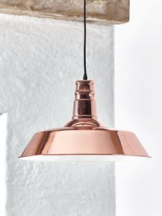 Made from lightweight iron with a high shine copper finish, our oversized pendant exudes industrial style. Each light includes a matching copper ceiling rose and a simple black cotton flex. Perfect for adding a pop to colour over your kitchen island or table top, this pendant has a white interior that reflects the light around your space. Also includes a vintage style cage bulb, to complete this industrial inspired look. Please note image in our catalogue is incorrect, the inner colour of…