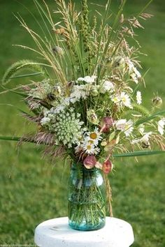 Mason jars filled with wildflowers, garden blooms, and native grass creates simple and natural centerpieces for an outdoor wedding. I don't love the mason jar, its a little over done now a days Wedding Jars, Wedding Centerpieces, Wedding Decorations, Wedding Ideas, Table Decorations, Fresh Flowers, Wild Flowers, Beautiful Flowers, Floral Wedding