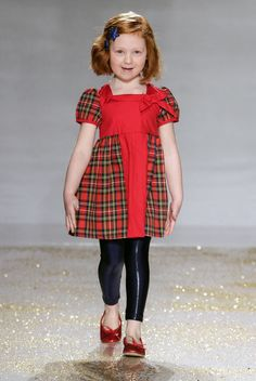 NEW YORK, NY - A model walks the runway at the Vogue Bambini showcase featuring SnoPea during the 2013 www.petitePARADE.com Kids Fashion Week at Industria Superstudio on March 10, 2013 in New York City. (Photo by John Parra/Getty Images for petiteParade.) Here, the holidays get a twist when a traditional frock, like this charming plaid number from SnoPea, meets shiny black leggings. www.snopeawear.net