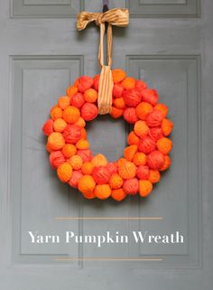 Add a touch of fall color to your front porch with this pumpkin wreath!