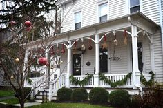 Enhance your outdoor holiday decor by hanging ornaments from a front porch or trees. If the weather in your area is harsh, use plastic instead of glass and hang pieces with thick red ribbon or heavy-duty wire.