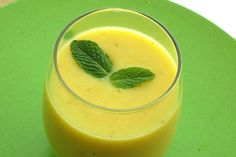 Tropical Sunshine Smoothie - Smoothie with mango and banana and a hint of ginger and mint for a twist.