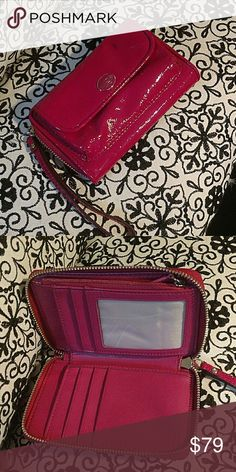Coach fuchsia patent leather wallet wristlet Great pre-loved condition, very hard to find. Wear this as a wristlet or as a wallet in a bigger bag. Patent is in perfect condition no cracks only a stain on the front as seen in the first pic. I've seen this wallet as high as $150. Bundle 3+ items for 30% off  in honour of memorial day weekend. Coach Bags Clutches & Wristlets