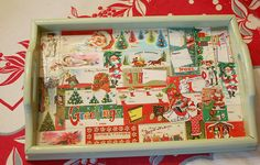 Tray embellished with vintage gift tags. Photo by Georgiapeachez