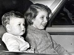 Sitting pretty with his big sister: The chubby-cheeked Andrew is taken for a car ride with ten-year-old Princess Anne in March 1961, just a few weeks after his first birthday.