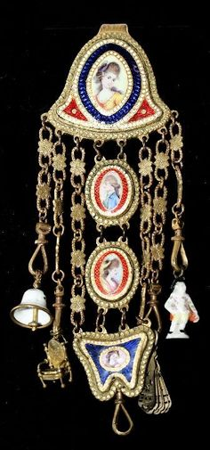 A French Gold Plated and Enamelled Chatelaine, 19th Century.