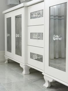 Start with builder-grade cabinets & add curved legs, mirrored door fronts & glass pulls ... from Sarah Richardson design ideas