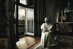 HRM Queen Elizabeth II There have been many iconic photos of the Queen, but this one taken by famous photographer Annie Leibovitz conveys her regality while presenting her in a state of contemplation accented by the eternally inclement English weather. Taken in Buckingham Palace, the shot caused a furor in the British tabloid press when Leibovitz asked the Queen to remove her crown. Date: 2007. Photographer: Annie Leibovitz.