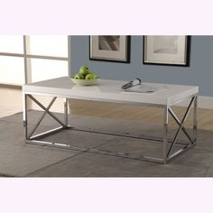 Dazzle guests at your next cocktail party with this sleek and glossy contemporary chrome table. The white tabletop is sturdy enough to hold an array of beverages and hors d'oeuvres while providing a s