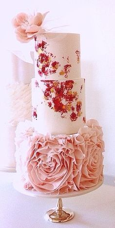 Pink ruffle wedding cake by Yummy Cupcakes and Cakes