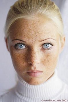 Striking searching gaze at odds with the freckled innocence