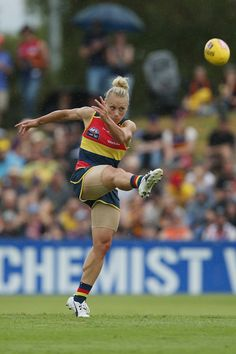 Erin Phillips Photos Photos - Erin Phillips of the Crows in action during the 2017 AFLW Round 01 match between the Adelaide Crows and the GWS Giants at Thebarton Oval on February 4, 2017 in Adelaide, Australia. - AFL Women's Rd 1 - Adelaide v GWS