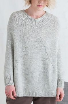 """Knitting Pattern for Marblehead Poncho - Pullover poncho with sleeves in stockinette with a reverse stockinette panel and ribbing. Sport weight yarn. Designed by Lana Jois. DK yarn. Finished Size: 40 (44, 48, 52, 56, 60)"""" hip circumference."""