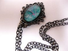 I made exact same necklace! Bought the pendant&chains& stuffs at Michaels' craft store years ago. Very easy!