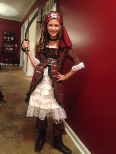 This Brown Coat Pirate Costume for girls is made exclusively by us and will look amazing for her next costume event.