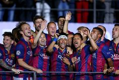 Neymar (C) of Barcelona leads the celebrations with team mates after the UEFA Champions League Final between Juventus and FC Barcelona at Olympiastadion on June 6, 2015 in Berlin, Germany.