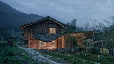 WEI Architects used traditional materials and construction techniques to convert a derelict Chinese house into a guesthouse, featuring curving tiled roofs.