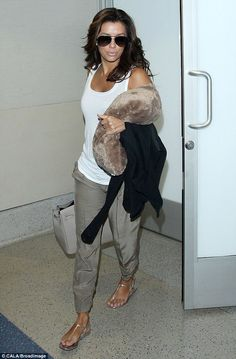 Easy does it! Eva Longoria was dressed casual in a tank top, relaxed trousers and sandals for her flight at Los Angeles International Airport on Thursday