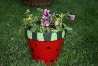 Watermelon flower pot...Paint on a clay pot.