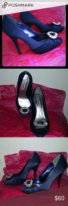 """Nina Elvira satin pumps size 9/39 With sophistication and class the bestselling Crystal D' orsay gets a high fashion update. Standing with elegance on a 4"""" heel the Elvira pump is the ultimate statement of glamour. Lustrous navy satin will stand out. Razzle dazzle in these platform beauties! New without a box. Right shoe is missing one rhinestone. Nina Shoes Platforms"""