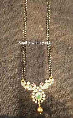black_beads_necklace_peacock_pendant.jpg (513×829)