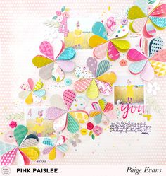 Re-imagine your favorite punches and use them in ways you never imagined! Paige Evans uses a heart punch to create these beautiful paper flowers on her latest layout. @pinkpaislee