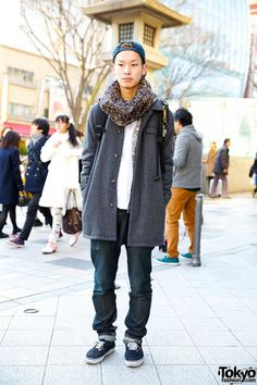 We met 21-year-old Naoki in Harajuku and we found out he's a hair stylist at the Lipps hair salon. He is wearing an A.P.C. coat over a Bedwin t-shirt and N. Hoolywood jeans. His backpack and cap are from Supreme and his sneakers are Vans. His necklace is E.N.noir and his snood is Mr. Gentleman. (Tokyo Fashion, 2014)