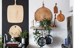 Cutting boards hung on the wall make great use of available vertical storage—and look beautiful on display in a group.