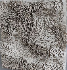 Fenella Elms - Ceramics Artist - Flows - Mounted for wall hanging, these works are intuitively built in porcelain clay to create shifting perspectives. Individually made beads of clay joined to a sheet of porcelain with slip before the whole work is fired together to make one, single piece.