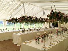 Long tables with hanging ladders above with overflowing flowers! A theme of pretty flowers with combination of pinks, greens and golds to tie it all together. Take a look at our board for more photograph inspiration or head over to our blog dedicated to the couples day at trianglenursery.m...
