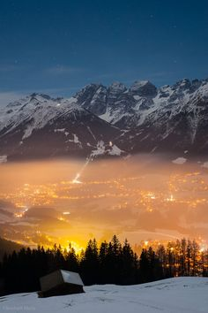 Winter night - Austrian Alps - Villages Fulpmes and Mieders appear in the valley