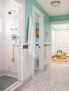 The light beach-inspired color scheme opens up this narrow bathroom. This makeover also includes some hotel-style luxuries, such as radiant heat in the floors, a private toilet compartment located next to the shower, and a heated towel rack that ensures quick-drying towels -- a must for humid beach locations.