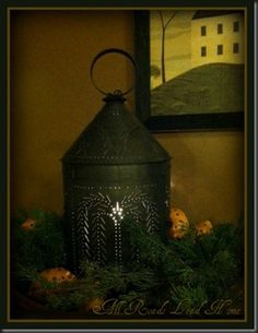 tin punch lantern with clove studded oranges