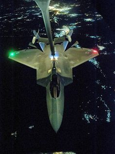 A photograph taken on Sept. 26 and released today by the U.S. Air Force shows a U.S Air Force KC-10 tanker aircraft refueling an F-22 Raptor fighter before strike operations against Islamic State targets in Syria.