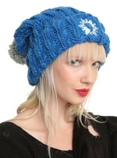 Large knit pom beanie from Frozen with an embroidered Elsa silhouette & snowflake design.