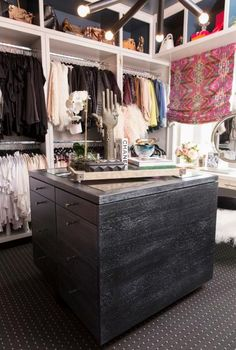We love this mix of light and dark features that create the perfect closet space. #HomeDecor #DreamCloset
