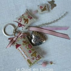 Keychain idea with attached cross stitch, ribbon and a metal heart. Cross Stitch Finishing, Cross Stitch Love, Cross Stitch Designs, Cross Stitch Patterns, Cross Stitching, Cross Stitch Embroidery, Hand Embroidery, Creation Couture, Sewing Accessories