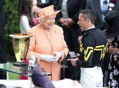 The Queen looked happy to chat with jockey Frankie Dettori as she presented him with a pri...