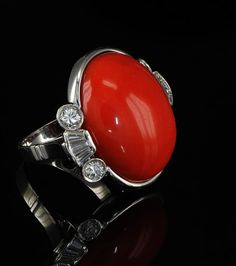 Stunning boule of red coral and diamond Vintage ring an Unique. £2,650.00, via Etsy.