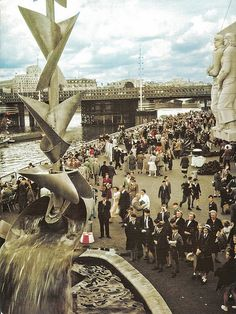 Festival of Britain - This is a view of the Festival of Britain exhibition site on the south bank looking eastwards. The temporary pedestrian bridge upstream of Charing Cross Railway Bridge can be clearly seen in the background, see link. Possibly the opening day of the exhibition the 3rd May 1951.