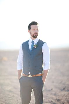 brown belt, vest, rolled up sleeves. photo: sarah tyler photography