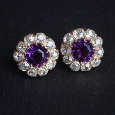 Purple, the color of royalty, will have you feeling like a queen in this stunning pair. Antique earrings set with Amethyst  surrounded by chunky old-cut Diamonds.  Jogani Beverly Hills