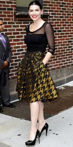 Look of the Day › August 30, 2011 WHAT SHE WORE Margulies filmed a Late Show with David Letterman appearance in a houndstooth Carolina Herrera skirt and sheer blouse that she paired with patent leather heels and gold hoops.